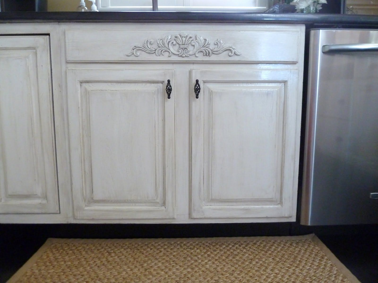 white appliances make it work painting kitchen cabinets white Distressing white cabinets with glaze and sandpaper Also added a piece of decorative moulding Lowe s to the area under the sink