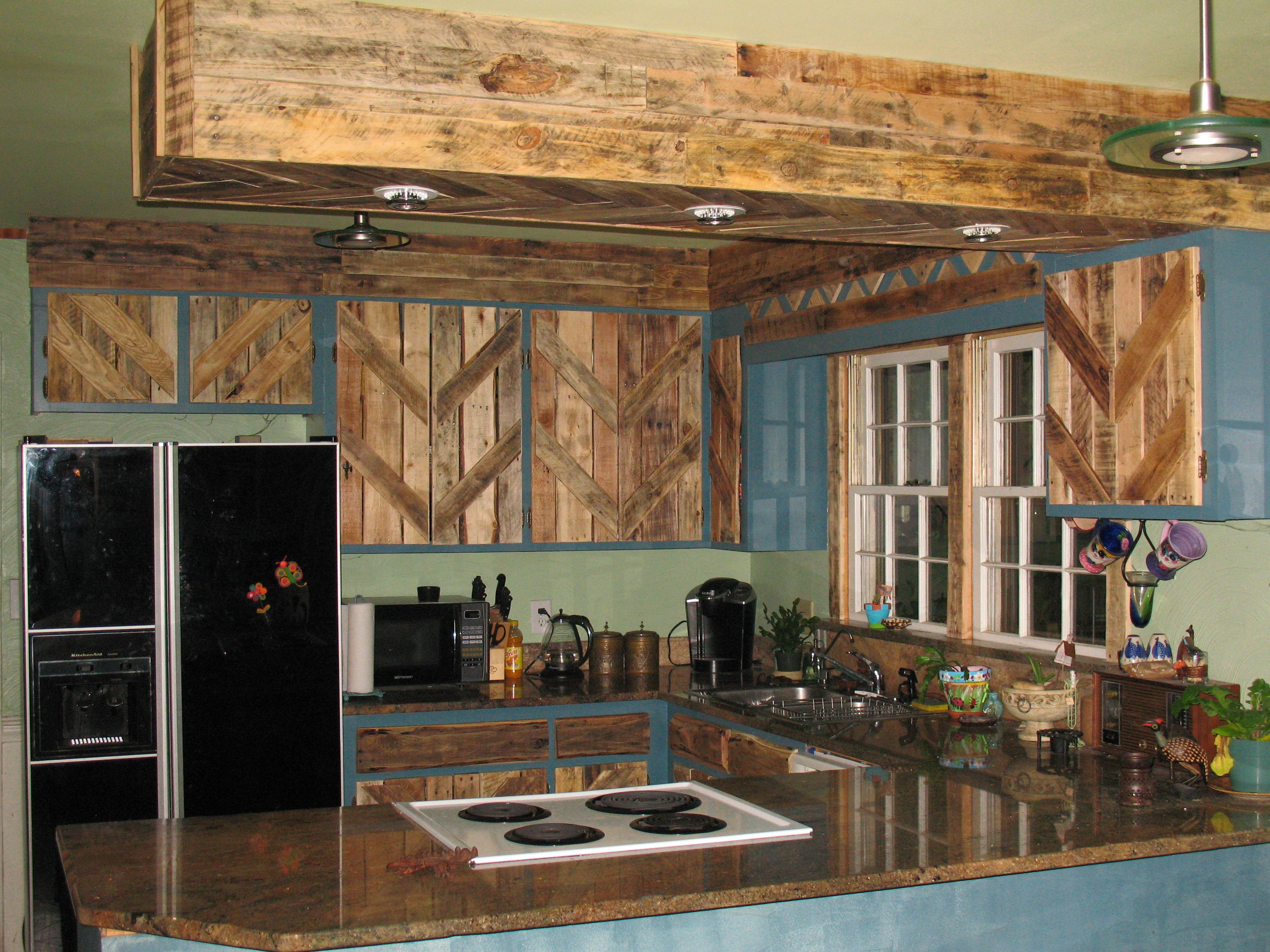 used kitchen cabinets Reclaimed Kitchen Cabinets Pallets used to reface the cabinet doors With Love From My