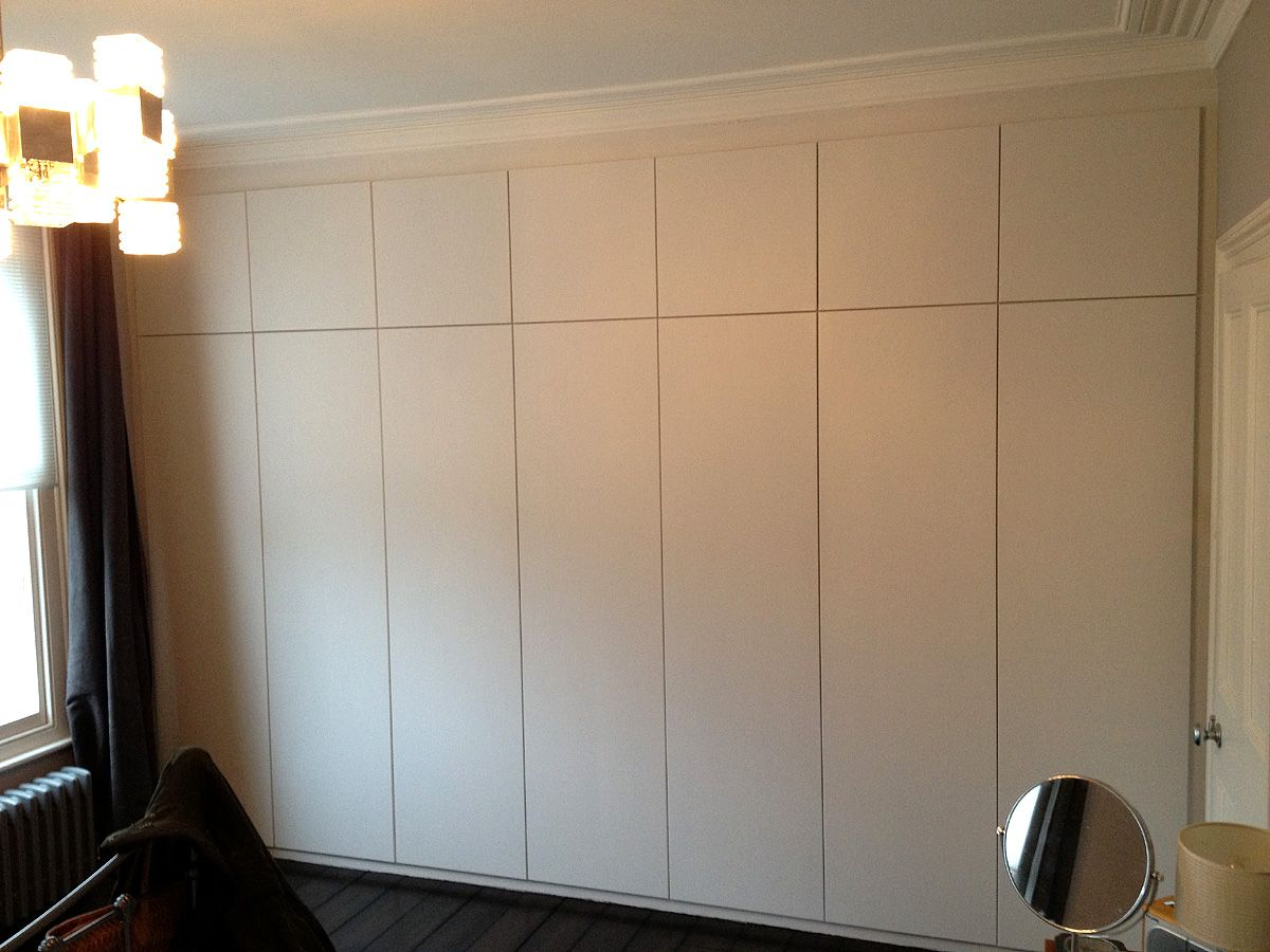 mdf kitchen cabinet doors Fitted wardrobe push to open doors Wandsworth road