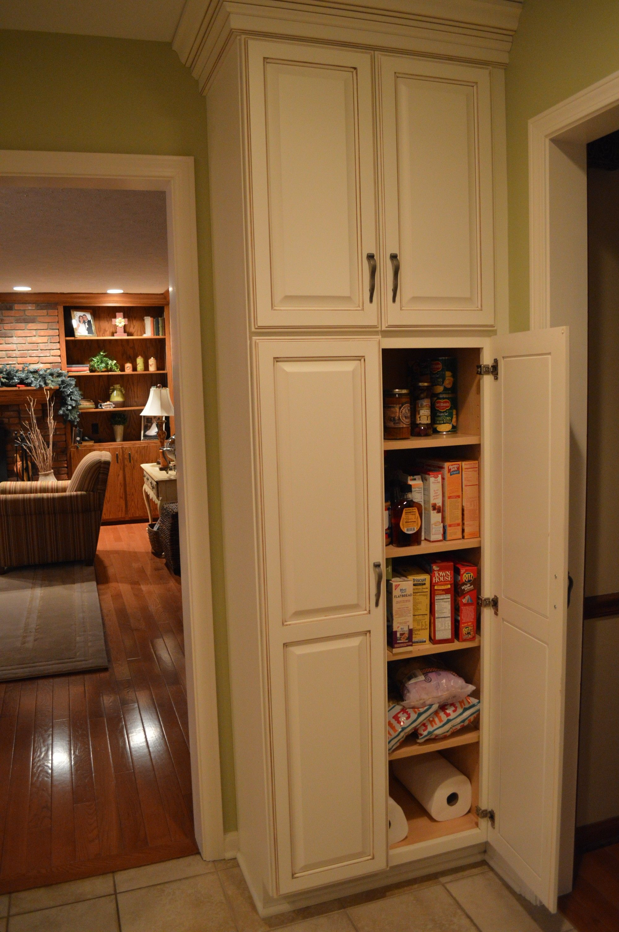 narrow cabinet for kitchen White Wooden Tall Narrow Pantry Cabinet With 4 Maple Wood Shelves And Wooden Door Panel Astounding Free Standing Corner Pantry Cabinet Design Furniture