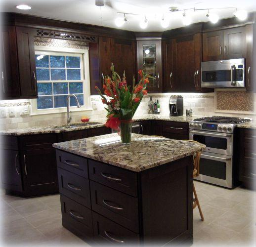 backsplash lighting kitchen cabinet lighting Backsplash Tiles Completed Kitchen Mocha Maple Shaker Cabinets Exotic Granite Countertops Track Lighting And Under Cabinet Lighting