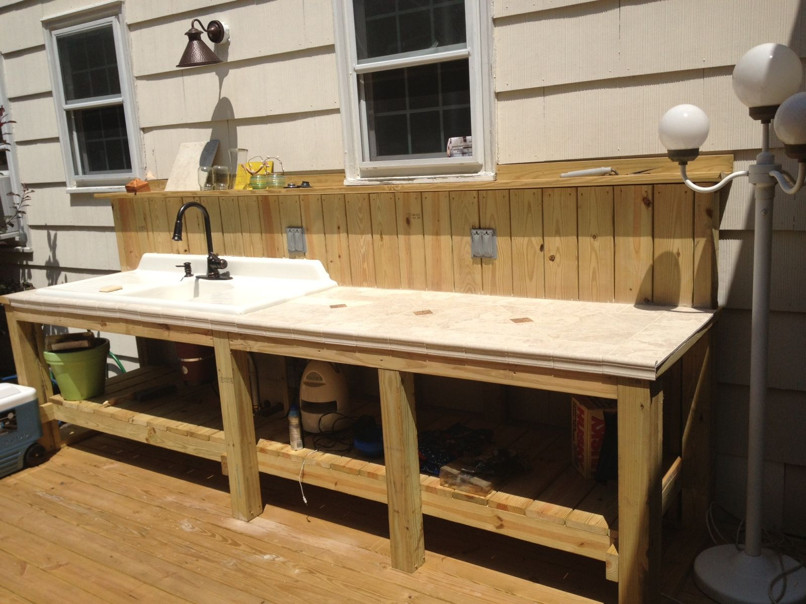outdoor kitchen sink Outdoor sink and countertop area complete with garbage disposal