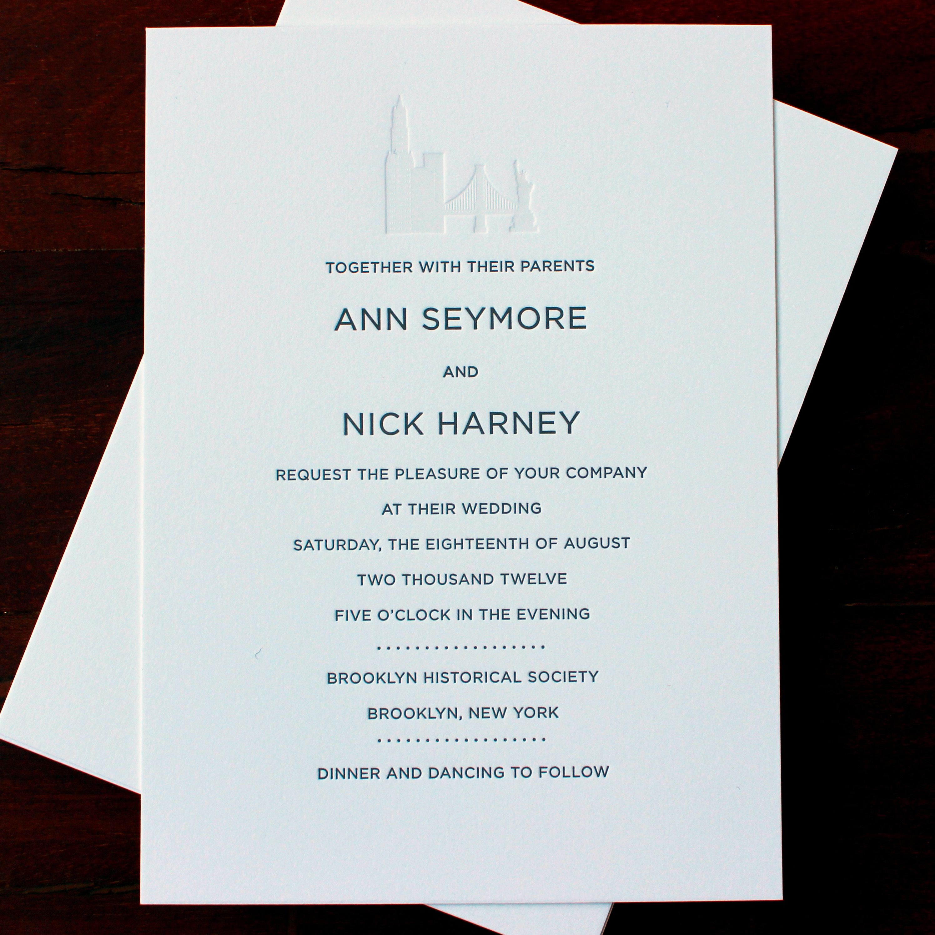embossed wedding invitations Classic sans serif letterpress wedding invitation with blind embossed New York skyline detail