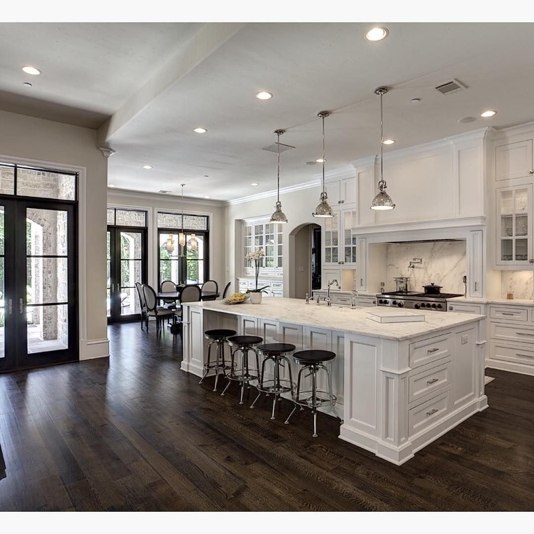 wood floor in kitchen Love the contrast of white and dark wood floors By Simmons Estate Homes