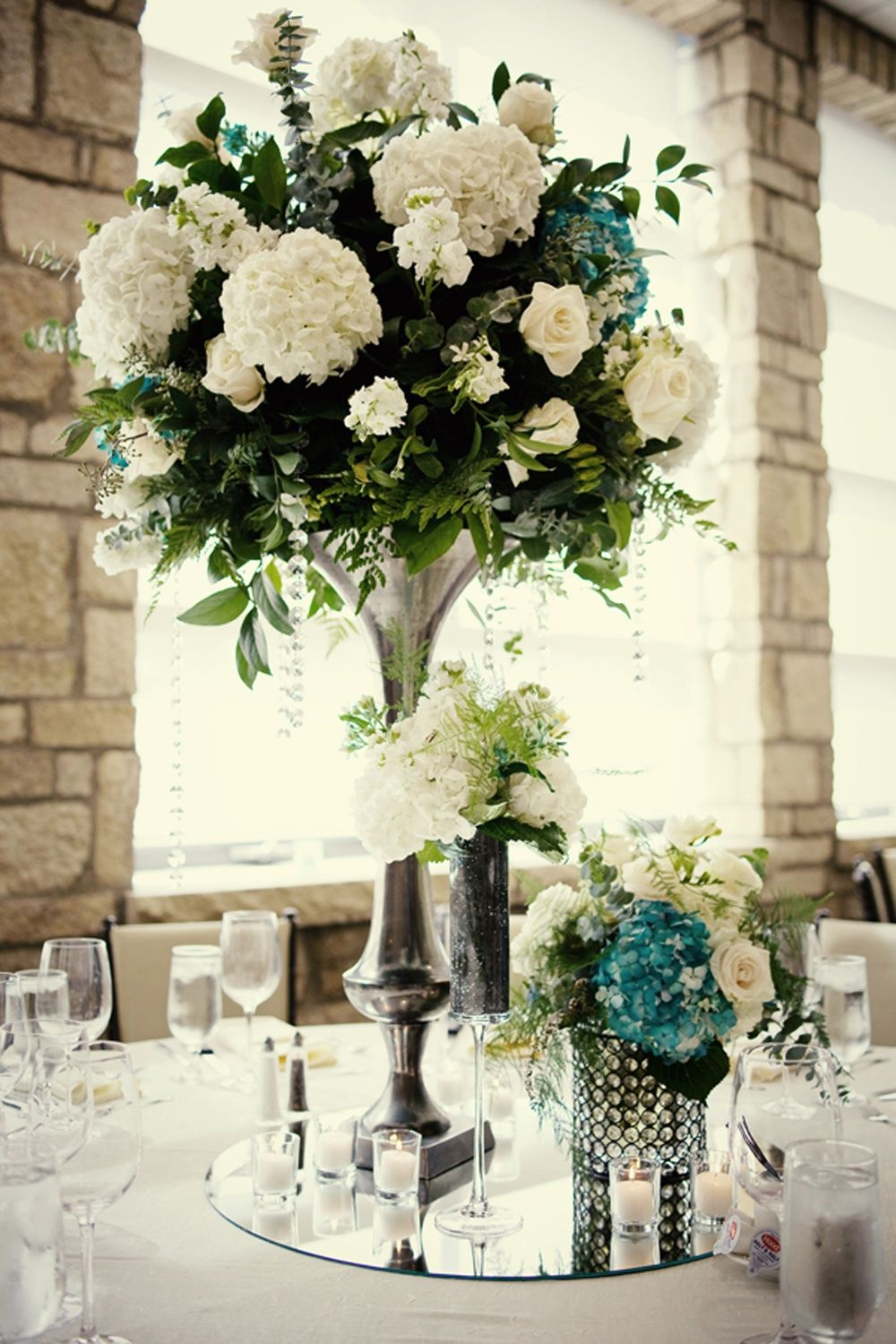 centerpieces for wedding elegant wedding reception centerpieces ivory hydrangeas teal accents Real Wedding Weddings Styles and Summer