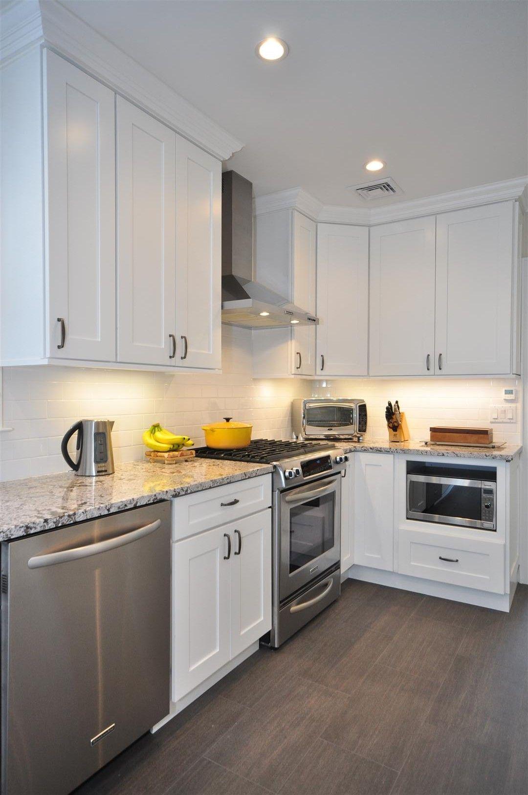 white cabinet kitchen white shaker kitchen cabinets Gray Floor Gray Counter tops