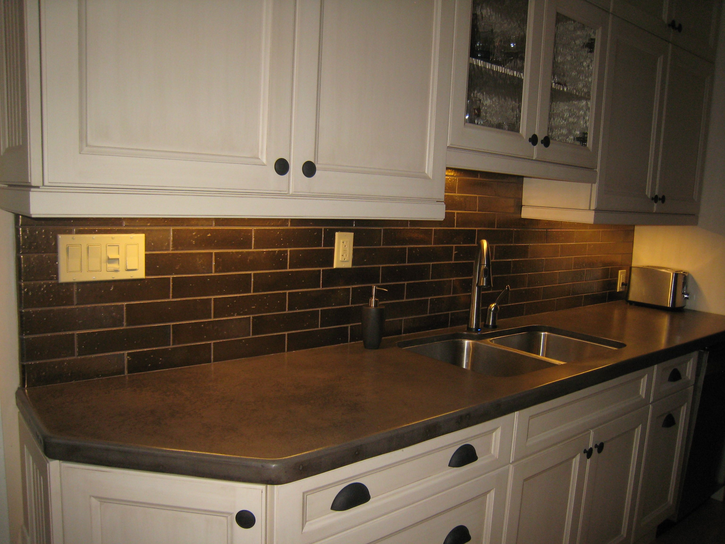 kitchen backsplash kitchen subway tile backsplash Interior Dark Stones Subway Brick Backsplash With White Cabinets As Well As Concrete Countertop Designs