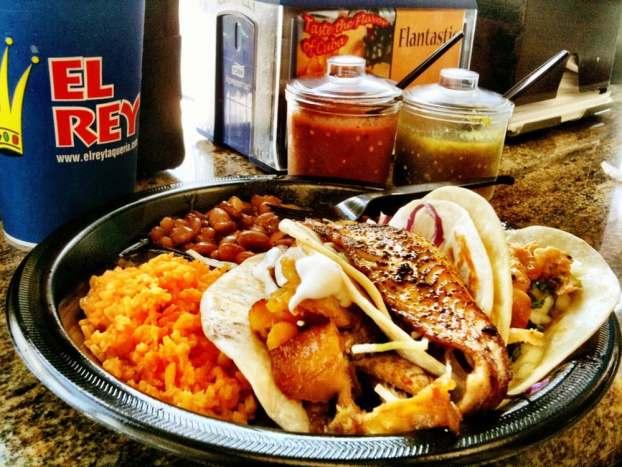 El Rey Taqueria - Houston, TX, United States. The Three Amigos Taco plate. From L-R. Cuban Taco. Fish Taco. Rotisserie Chicken taco w/ cilantro and onions.
