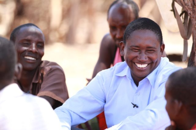 smiling Tom Lalampaa among a group of people