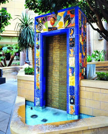 Paseo Cesar Chavez by Roberto Gil de Montes. Located at the corner of Cesar Chavez and Vignes streets, each of three water fountains was designed to have a different sound; each is clad in colorful handmade tiles.