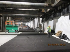 Installation of waterproofing and other materials at the portal to the tunnel in Leimert Park.