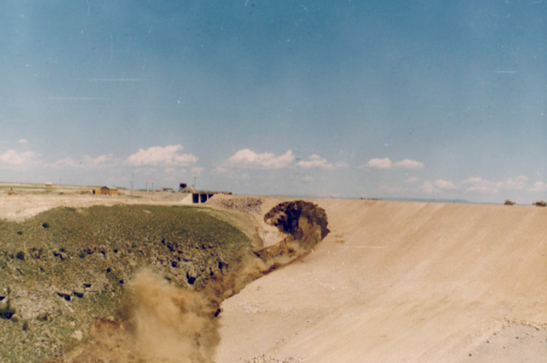 Figure 8. The hole has continued to enlarge, eating its way back into the mass of the dam. Here it is about to breach the dam crest.