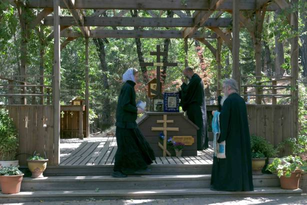 Fr. Athanasius placing the icon on the grave of Hieromonk Seraphim (Rose).