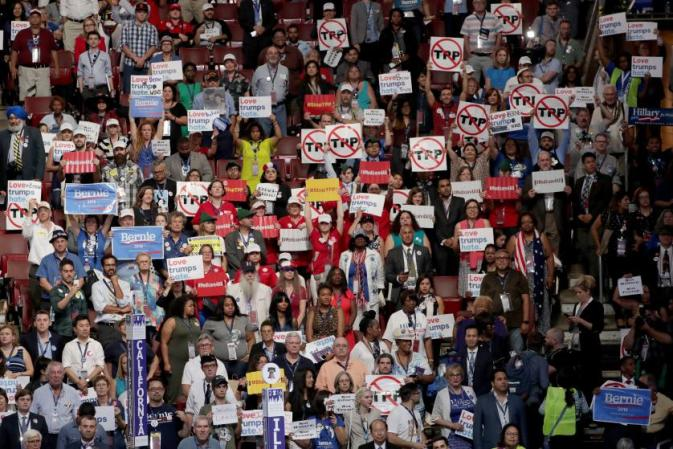 PHILADELPHIA, PA - JULY 25: Delegates and attendees in support of Sen. Bernie Sanders (I-VT) hold up signs on the first day of the Democratic National Convention at the Wells Fargo Center, July 25, 2016 in Philadelphia, Pennsylvania. An estimated 50,000 people are expected in Philadelphia, including hundreds of protesters and members of the media. The four-day Democratic National Convention kicked off July 25. (Photo by Alex Wong/Getty Images)