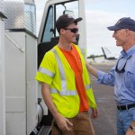 Gov. Rick Scott speaks with Florida National Guard members and utility workers following Hurricane Matthew