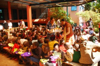 Volunteers serving meals to the children at the Sathya Sai Centre in Nairobi