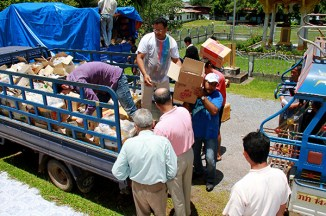 Unloading relief supplies for those affected by the flood