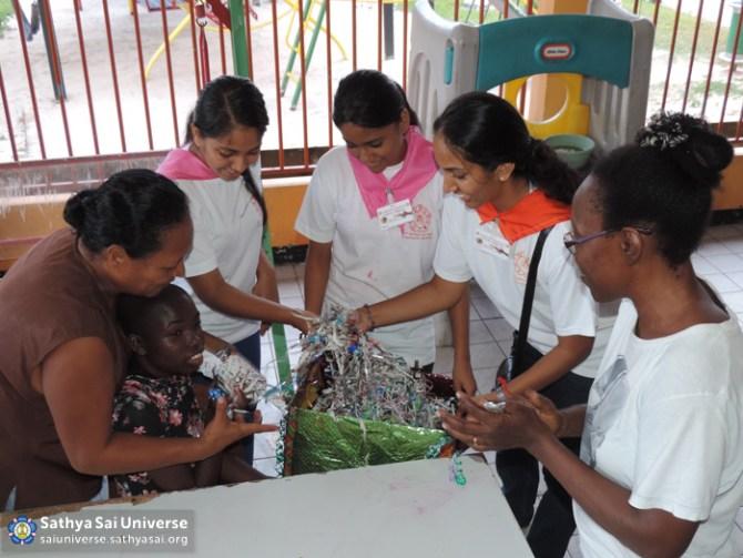 Suriname STP - Entertaining disabled child