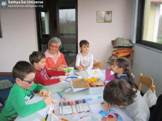 Italy 2016 The younger children colouring animal masks.jpeg copy
