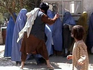 Taliban beating woman in public.Wikipedia