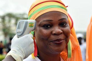 A Malabo, en Guinée équatoriale, opération de prévention avant un match de foot entre le Sénégal et l'Algérie, en 2015, pendant la coupe d'Afrique. CRÉDITS : ISSOUF SANOGO - AFP