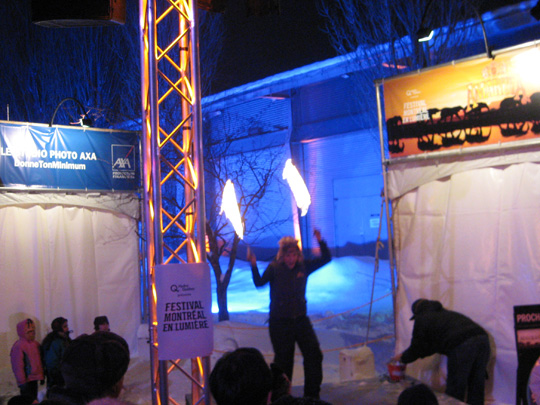 Woman dancing with fire at the Montreal All-Nighter