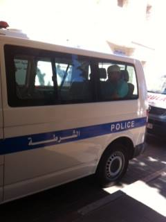 Photo via Addameer of injured protester taken from Ramallah Hospital in police van