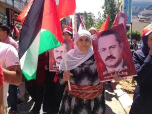 Ahed Abu Ghoulmeh's mother marching in Abu Ali Mustafa commemoration in Palestine