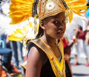 Carafiesta parade kid in gold