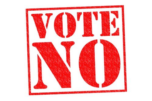 VOTE NO red Rubber Stamp over a white background.