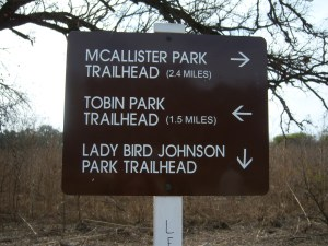 Photo of the sign along the trail with distances.
