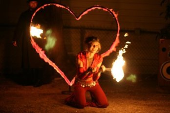 Sage spinning Fire Poi with flaming heart on Valentine's Day