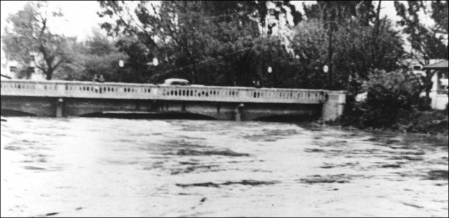 Water levels at the A Street bridge during the 1963 flood. Top: Under an unspecified creek bridge during the 1963 flood, probably one of last pictures of Santa Rosa Creek before it was entombed. (Photo: Sonoma County Library)