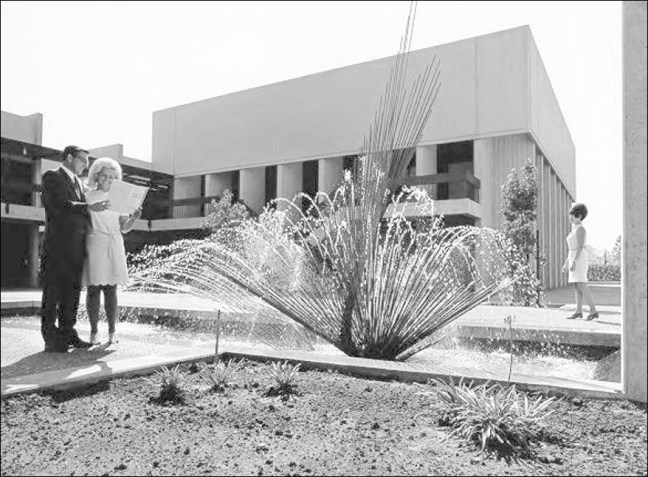 Joe Henderson, Assistant City Manager with a City Hall employee near the fountain in City Hall courtyard, 1969 (Photo: Sonoma County Library)