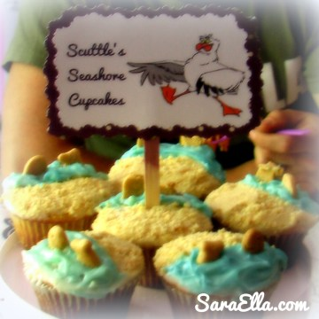 "Scuttle's Seashore Cupcakes. Just frost a cupcake half and half white white and blue frosting, then dip the white side in crushed Vanilla Wafers. Add cupcake flavored Goldfish to the ""water"" for fun!"