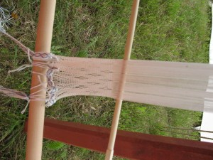 tablet woven bands hold the threads to be spranged