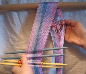 work to create a scarf, the technique is called sprang, the material is hand dyed, reeled silk