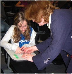 Carol works with a student