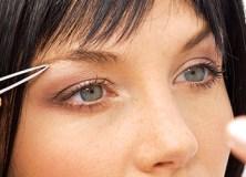 Choosing The Right Tweezers Woman Tweezing Eyebrows Feature