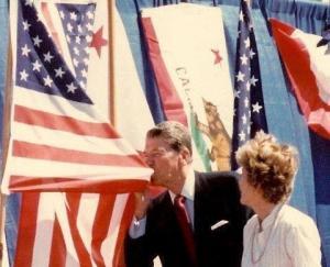 Reagan Kisses Flag