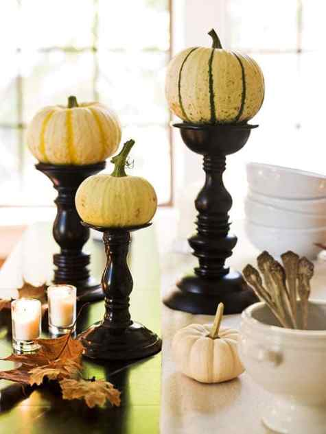 white pumpkins on candlesticks