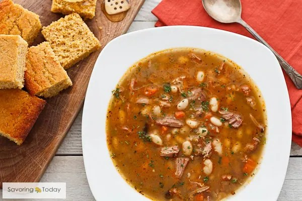 Bean soup recipe with smoked turkey, including stove top, slow cooker, and pressure cooker methods.