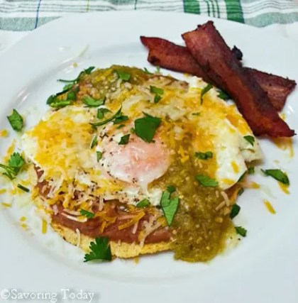 Familiar Mexican flavors of green chile, refried beans and corn tortilla layered under a soft cooked egg.