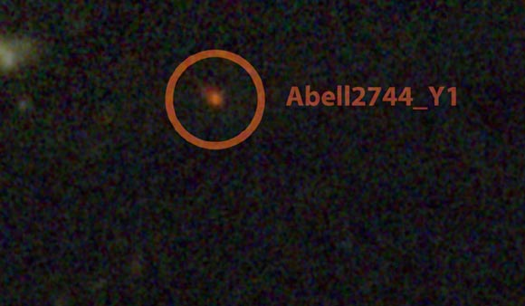 This image shows the galaxy Abell2744 Y1, one of the most distant galaxy candidates known. (Credit: NASA / ESA / STScI / IAC.)