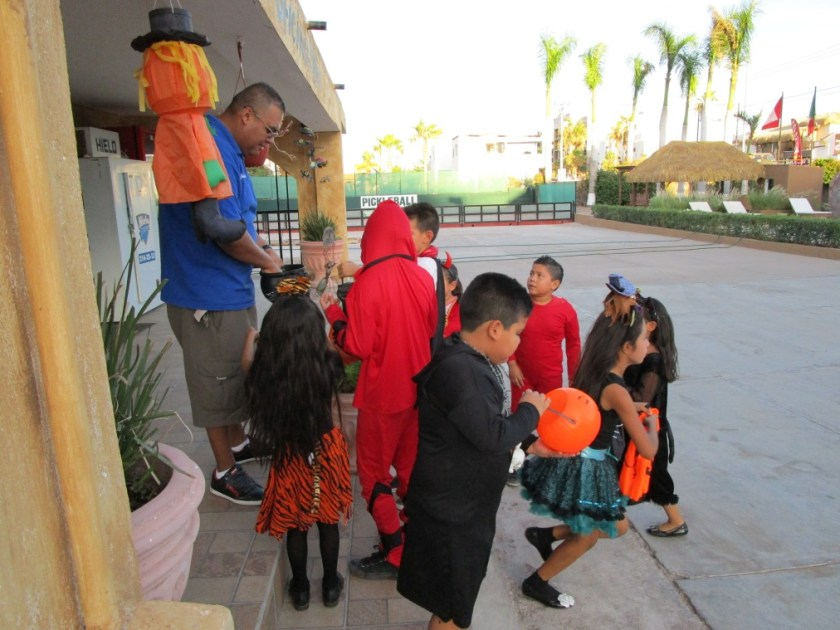 Jose surrounded by Trick or Treaters