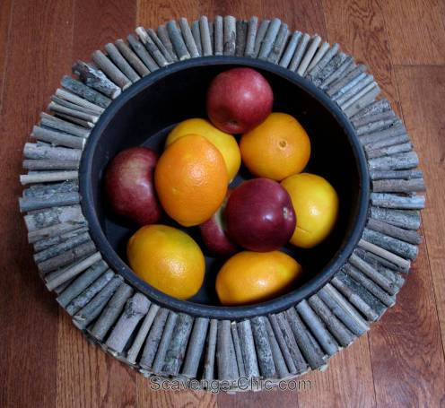 Making over a wooden salad bowl with sticks