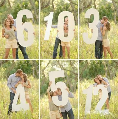 Photos of the Wedding Couple Holding the Table Numbers