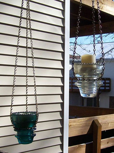 Votive candle lanterns made from glass insulators