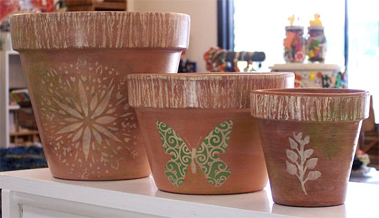 Terra cotta pots decorated with paint and stencils