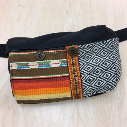 Fabric pouch refurbished by repairing the zipper and adding a front pocket made from salvaged materials.